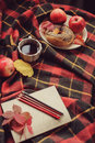Top view of cozy autumn morning at home. Breakfast with pot of tea and bagel with apples Royalty Free Stock Photo