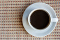 Top view of cup of black coffee on mat Royalty Free Stock Image