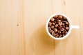 Top view cup coffee beans space text over wood background Stock Photos