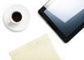 Top of view of cup of coffee and tablet near notes, concept of new technology Royalty Free Stock Images