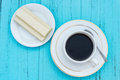 Top view cup of coffee and white chocolate wafer Royalty Free Stock Photo