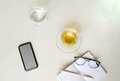 Top view cup of tea with cell phone, glass of water and glasses Royalty Free Stock Photo