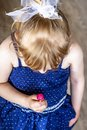 Top view on cutle little blond girl with her lollypop