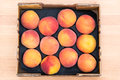 Top view of delicious red peaches in a box Royalty Free Stock Photo