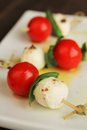 Top view delicious skewer boccocini cherry tomatoes basil caprese Stock Photography