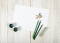 Top view of designer workplace equipped with green gouache jars, colored pencils, chalk, shavings and white paper Royalty Free Stock Photo