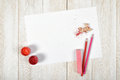 Top view of designer workplace equipped with red-pink gouache jars, colored pencils, chalk, shavings and white paper Royalty Free Stock Photo