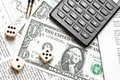Top of view of dice on financial chart near dollars and calculator Royalty Free Stock Photo