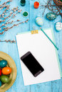 The top view of easter on wooden table office workplace in blue with copy space background for greeting card Royalty Free Stock Images