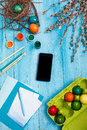 The top view of easter on wooden table office workplace in blue with copy space background for greeting card Stock Image
