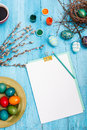The top view of easter on wooden table office workplace in blue with copy space background for greeting card Royalty Free Stock Image