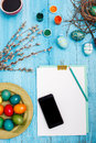 The top view of easter on wooden table office workplace in blue with copy space background for greeting card Royalty Free Stock Photography
