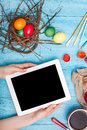 The top view of easter on wooden table office workplace in blue female hand with laptop Stock Image