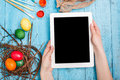 The top view of easter on wooden table office workplace in blue female hand with laptop Stock Images