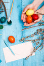 The top view of easter on wooden table office workplace in blue female hands and eggs Royalty Free Stock Photos
