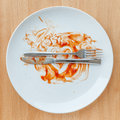 Top view of empty plate, tomato sauce smeared on finished plate. Royalty Free Stock Photo