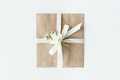 Top view of envelope with flower and ribbon isolated on white