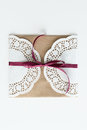 Top view of envelope with lace and ribbon isolated on white