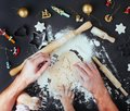 Top view of fathers and kids hands making Christmas tree cookies Royalty Free Stock Photo