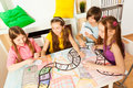 Top view of four kids playing the tabletop game Royalty Free Stock Photo