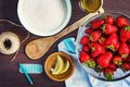 Top view of fresh strawberries, sugar and lemon zest. Strawberry jam ingredients prepared to be cooked. Royalty Free Stock Photo