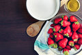 Top view of fresh strawberries and sugar. Strawberry jam ingredients prepared to be cooked. Royalty Free Stock Photo