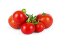 Top view of fresh tomatoes, whole and half cut, isolated on whit Royalty Free Stock Photo