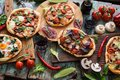 Top view of freshly prerared delicious pizzas. Italian style rus Royalty Free Stock Photo