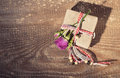 Top view of gift box tied with decorative ribbon and rose flower