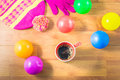 Top view gloves, Silk hat, colored balls and a cup of coffee on wood table. In the winter. Royalty Free Stock Photo