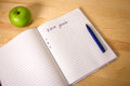 Top view 2017 goals list with notebook, green apple on wooden desktop Royalty Free Stock Photo
