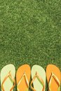 top view of green and orange flip flops Royalty Free Stock Photo