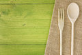 Top view green table kitchen wooden spoon fork Stock Photos