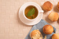 Top view of green tea with mint  in a white cup with vanilla muffins. Royalty Free Stock Photo