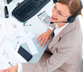 Top view of a happy business woman working at desk Royalty Free Stock Image
