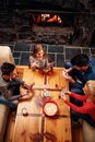 Top view of Happy family having fun and playing cards Royalty Free Stock Photo