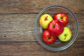 Top view healthy apple in glass bowl on wood background Royalty Free Stock Photography