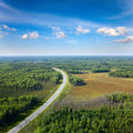 Top view on highway in forest aerial of unlimited space of plain and cars which are riding Royalty Free Stock Photo