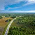 Top view on highway in forest aerial of unlimited space of plain and cars which are riding Stock Photo