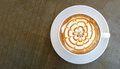 Top view of hot coffee cappuccino latte art top view on concrete background Royalty Free Stock Photo