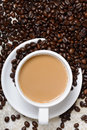 Top view of hot coffee cup and beans a Royalty Free Stock Photo