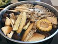 Top view of hot pot shabu shabu with mixed vegetable in black so