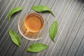 Top view if a cup of Green tea and leafs decoreted nicely on wood talbe de Royalty Free Stock Photo
