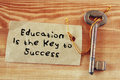 Top view image of key with note and the phrase education is the key to success.