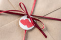 Top view of kraft envelope with tag with two hearts and ribbon
