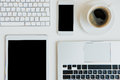 Top view of laptops with digital tablet and smartphone on table top Royalty Free Stock Photo