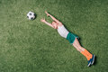 Top view of little boy pretending playing soccer on grass Royalty Free Stock Photo