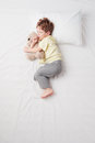 Top view of little boy sleeping in Foetus pose Royalty Free Stock Photo