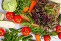 stock image of  Top view of lots of vegetables on wooden table