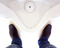 Top view of a man legs in front of urinal in men toilet Royalty Free Stock Photo